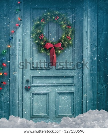 Rustic barn door with Christmas wreath - stock photo