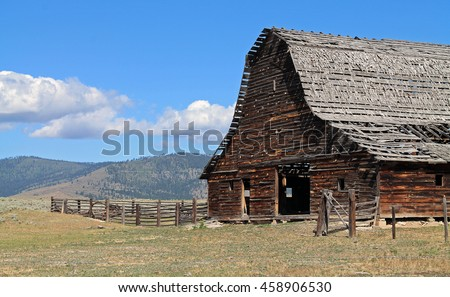 Rustic Barn with Dilapidated Roof in Sagebrush Country
