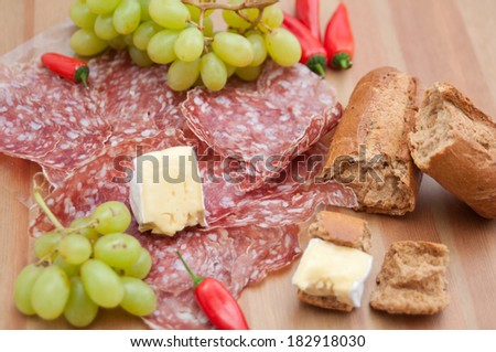 Rustic bread and cheese platter with grapes