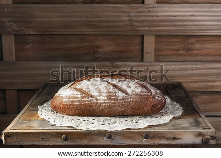 Rustic bread  on an old vintage wood table.