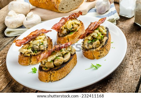 Rustic breakfast - garlic toast, fried mushrooms, scrambled eggs and ...