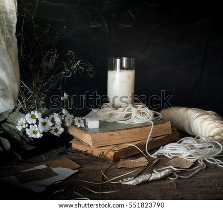 rustic breakfast. still life, vintage. the book chrysanthemums, the milk. black background. space for text