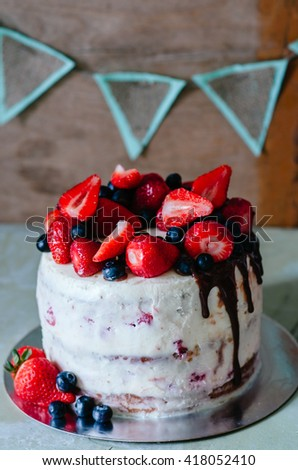 Rustic Cake With Berries And Strawberries On The Table