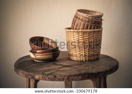Rustic Ceramic bowls and plates on wood background. side view, w