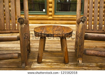 Rustic chairs on the deck of a cabin in the Smokies - stock photo