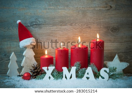 Rustic Christmas background with four advent candles burning - stock photo