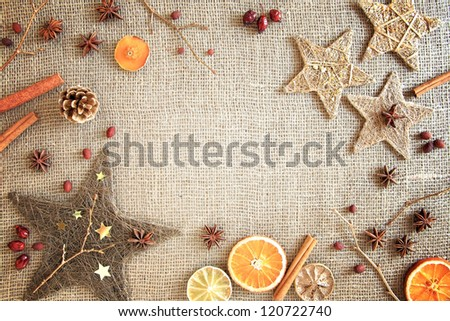 Rustic Christmas Border Of Seasons Ingredients And Decorations On A Burlap Background