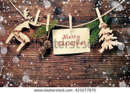 Rustic Christmas decoration on textured wooden background - stock photo