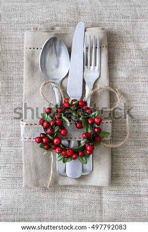 Rustic Christmas table setting on raw linen