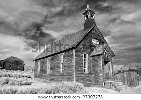 Rustic church building in California mining ghost town of Bodie in black and white - stock photo