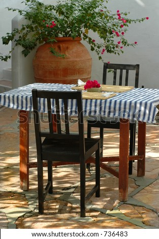 Rustic courtyard breakfast table - stock photo