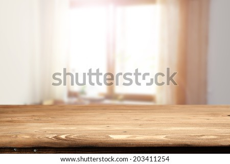 rustic desk and window  - stock photo