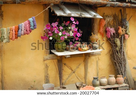 rustic display of pots,wool,and flowers