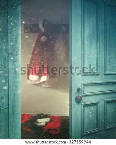 Rustic door opening into a room decorated for Christmas  - stock photo