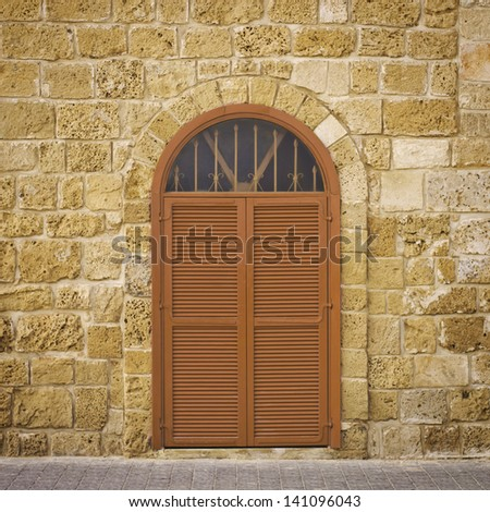 Rustic door set in an old brick wall