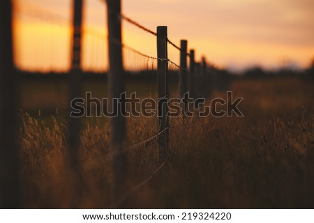 Rustic fence ranch in southern Iceland - stock photo