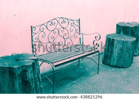 Rustic Garden Design Furniture   Ornate Metal Bench, Sitting Wooden Log  Chairs And Grunge Wall