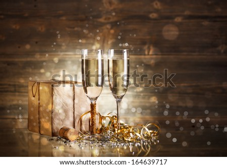 Rustic gift box with glasses of champagne