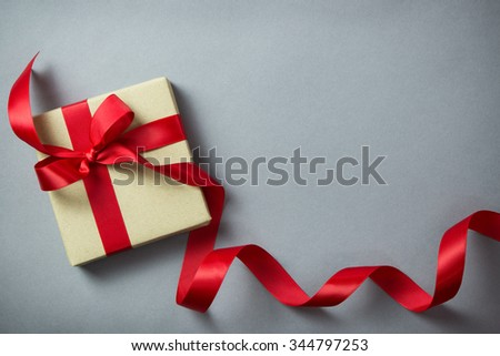Rustic gift box with red ribbon, with copy space