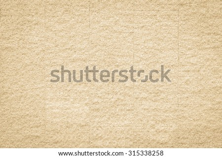 Rustic grunge granite tiled wall detailed pattern texture in natural light beige creme color tone: Rough rock stone tile wall finishing material detail wallpaper backdrop for interior background  - stock photo