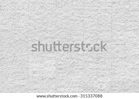 Rustic grunge granite tiled wall detailed pattern texture in natural light white grey color tone: Rough rock stone tile wall finishing material detail wallpaper backdrop for interior background  - stock photo