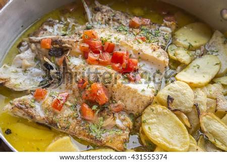 Rustic hake recipe - stock photo