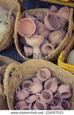 Rustic handmade ceramic clay brown terracotta cups souvenirs at street handicraft market in gafsa,Tunisia