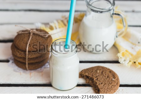 Rustic home made tasty  cookies on the wooden background with milk. Selective focus photo with shallow DOF.