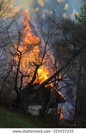 Rustic house burning
