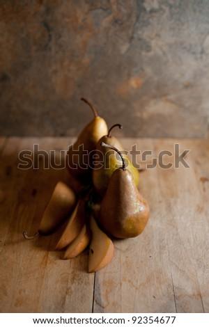 Rustic Image of Organic Bosc Pears on Old Cutting board - stock photo