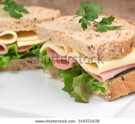 Rustic kitchen setting for fresh ham and cheese sandwich