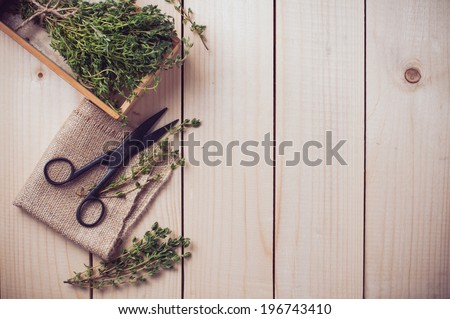 Rustic kitchen still life, dried herbs, old boxes and vintage scissors on a wooden table, home background - stock photo