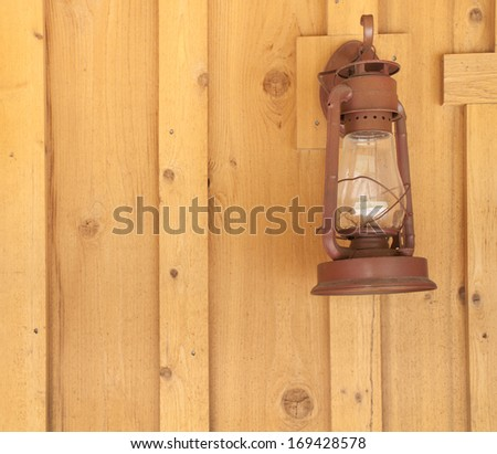 Rustic Lantern on Wood Panel Wall with room or space for text, copy, words.  Square