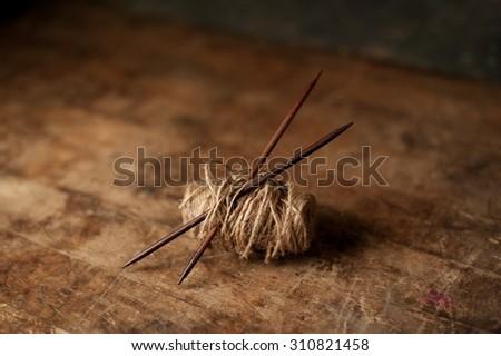 Rustic looking knitting needles in textured yarn - stock photo