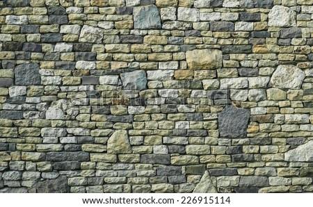 Rustic multicolor stone wall texture - stock photo