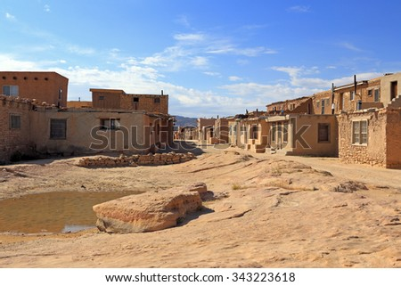 """Rustic old buildings form the """"Sky City"""" of Acoma Pueblo in New Mexico. - stock photo"""