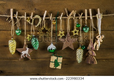 Rustic old christmas decoration on wood. Gold and brown colors. - stock photo