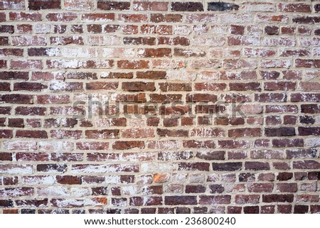 Rustic old fashioned vintage brick wall background texture - stock photo
