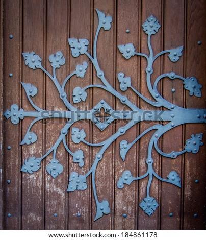 Rustic Ornametal Hinge On A Wooden Church Door - stock photo