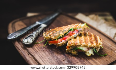 rustic panini on wooden board, selective focus