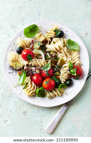 Rustic Pasta with Roasted Vegetables and Olives - stock photo