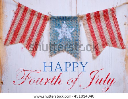 Rustic patriotic banner of three painted burlap flags on white washed wooden background. Center is white star on blue. Outside is red and white stripes with July 4th text - stock photo