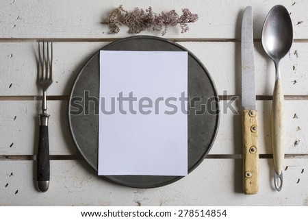 Rustic place setting menu on old white wooden - stock photo