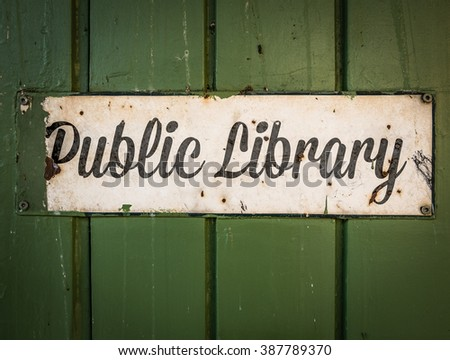 Rustic Retro Public Library Sign On A Green Wooden Background - stock photo