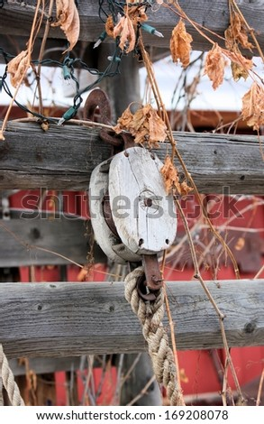 Rustic Rope and Pulley - stock photo