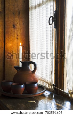 Rustic still life on a wooden window with a burning candle