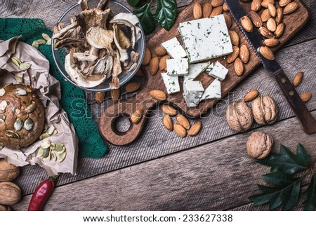 rustic style cheese with bread, cep and nuts. Food photo - stock photo