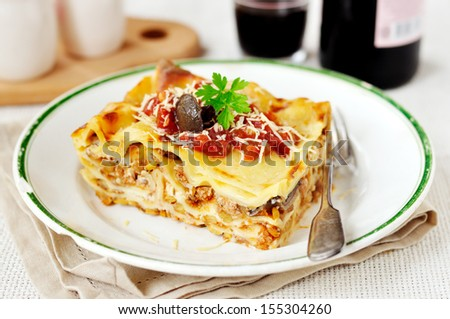 Rustic style lasagna with pork, mushrooms and lentils - stock photo