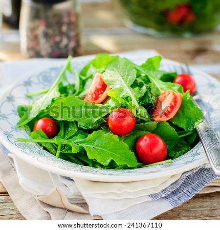 Rustic Style Rocket (Arugula) and Cherry Tomato Salad, square - stock photo
