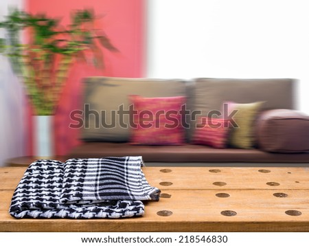 Rustic tabletop over moderm vintage  living room blurry background